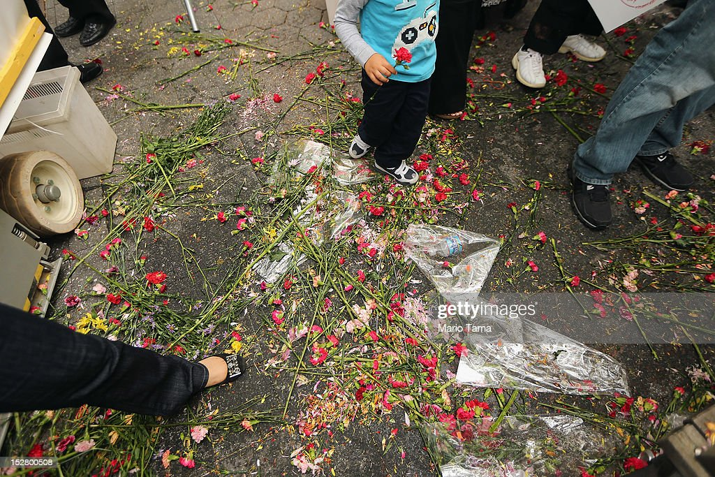 Flowers are seen on the ground after being thrown during a rally of groups opposing Iranian President Ahmadinejad's speech at the United Nations General Assembly on September 26, 2012 in New York City. Politicians including former New York Mayor Rudolph Giuliani, former House Speaker Newt Gingrich, former Homeland Security Secretary Tom Ridge, former New Mexico Governor Bill Richardson and former U.N Ambassador John Bolton spoke at the pro-democracy rally which also included Syrian pro-democracy protesters.