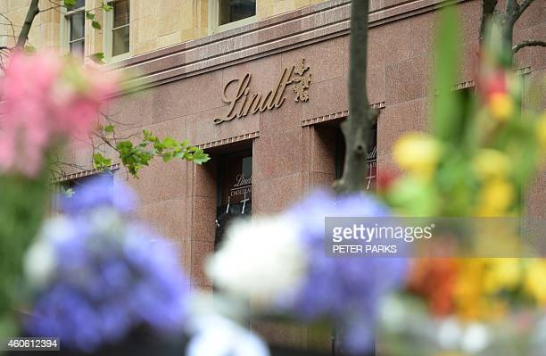 Flowers are seen outside the Lindt cafe the scene of a fatal siege in the heart of Sydney's financial district on December 18 2014 Prime Minister...