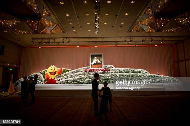 Flowers are seen surrounding a portrait of the businessman Masaya Nakamura the founder of video game company Bandai Namco and known as the 'father'...