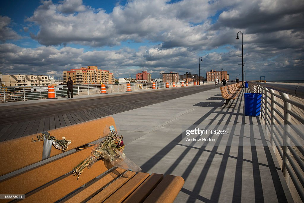Flowers are taped to a bench along the Long Beach boardwalk on October 25, 2013 in Long Beach, New York. The Long Beach boardwalk was severely damaged by Superstorm Sandy last year, which killed 285 people and caused billions of dollars in damage, though the boardwalk reopened today. Long Beach's new boardwalk is made of Brazilian hardwood and is estimated to have a lifespan of 30-40 year; the previous boardwalk was only scheduled to last three to seven years.