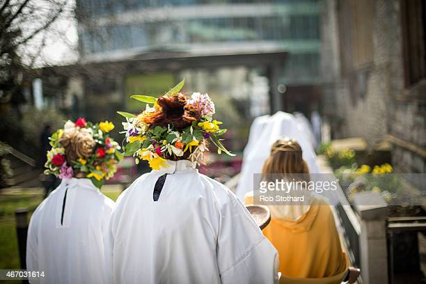 Flowers are worn in the hair as mrembers of The Druid Order celebrate the Spring Equinox with a ceremony at Tower Hill on March 20 2015 in London...