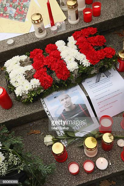 Flowers arranged into the name 'Enke' lie among a sea of candles and flowers in tribute to Hannover 96 goalkeeper Robert Enke at the conclusion of a...