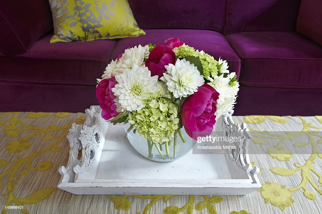 flowers arrangement in colorful setting : Stock Photo