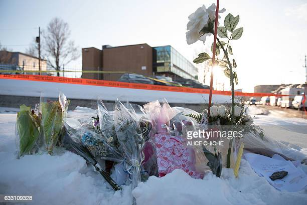 Flowers at a makeshift memorial near the Islamic Cultural Center in Quebec City Canada on January 30 2017 Gunmen stormed into a Quebec mosque during...