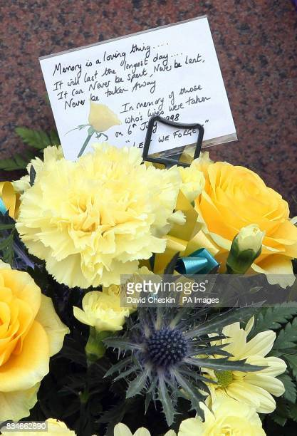 Flowers at the Hazlehead Park memorial statue for the Piper Alpha memorial service in Aberdeen