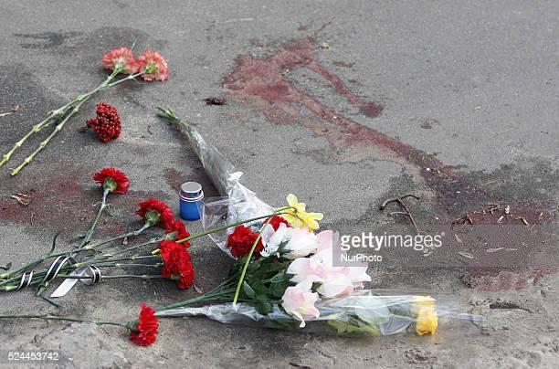 Flowers at the murder scene proRussian journalist Oles Buzyna after he was shot dead in KievUkraine on April 16 2015 Buzyna was shot dead in Kiev on...
