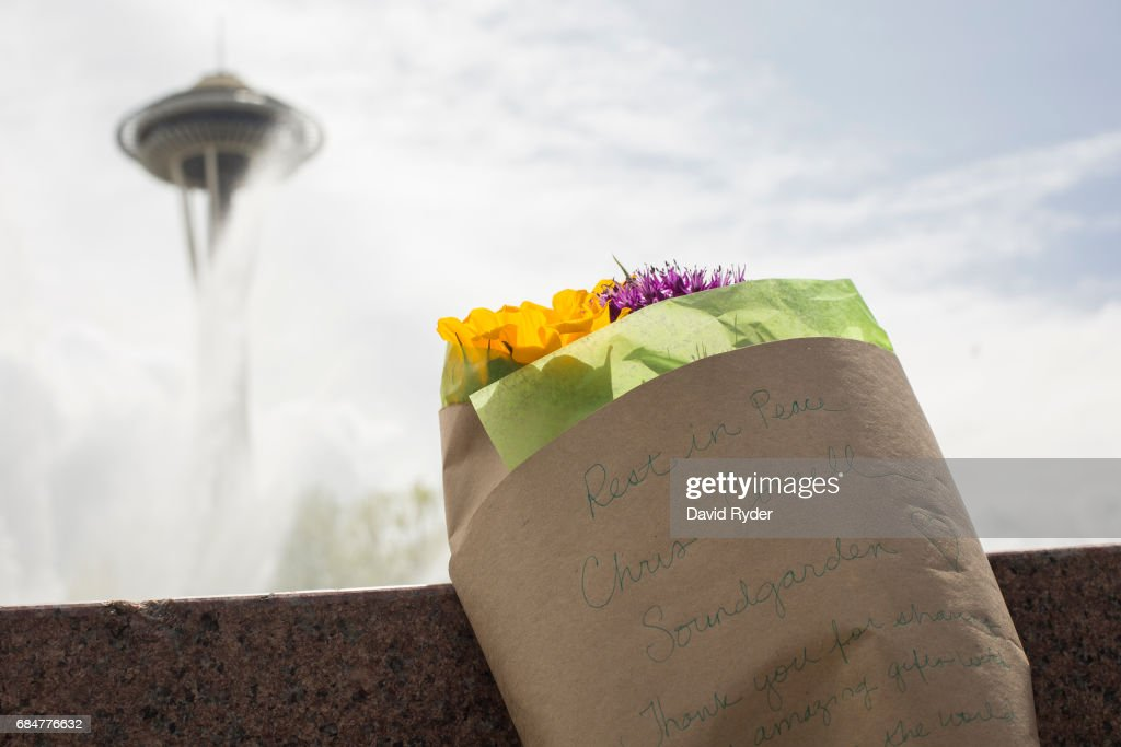 Flowers bearing a message in memory of Chris Cornell rest in front of a fountain in Seattle Center near the Space Needle on May 18, 2017 in Seattle, Washington. Musician Chris Cornell, a member of revered rock groups Soundgarden and Audioslave, was found dead overnight in Detroit at age 52.