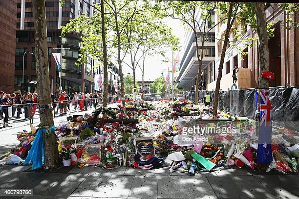 Flowers can been seen outside the Lindt cafe just prior to being removed at Martin Place on December 23 2014 in Sydney Australia Volunteers have...