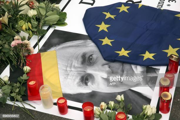 Flowers candles and an EU flag are placed on a picture of former German Chancellor Helmut Kohl in front of his house in Oggersheim near Ludwigshafen...
