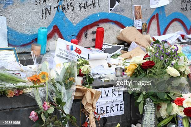 Flowers candles and messages are seen at a makeshift memorial for the victims of the Paris terror attacks at Place de la Republique in Paris France...