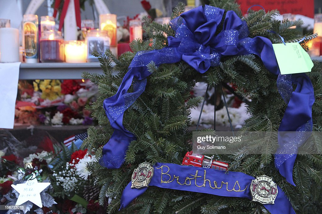 Flowers, candles and wreaths adorn a makeshift Memorial at the West Webster Fire Station on Wednesday, December 26, 2012 in Webster, New York. Law enforcement officials have not publicly identified which gun or guns were used to shoot the four firefighters, two of them fatally, or in what authorities have described as a brief standoff between William Spengler Jr., and a Webster police officer on Christmas eve.