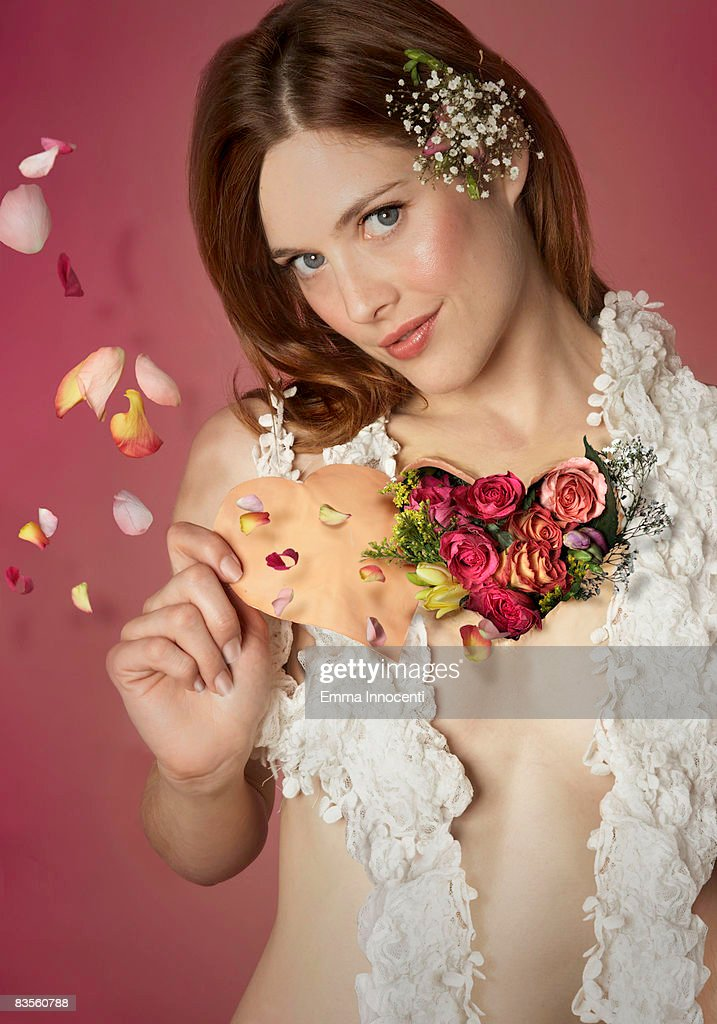 Flowers coming out of a woman's heart : Stock Photo