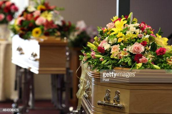 Flowers cover the coffins at the funeral of Noelene and Yvana Bischoff at the Gatton Baptist church on January 20 2014 in Gatton Queensland Australia...
