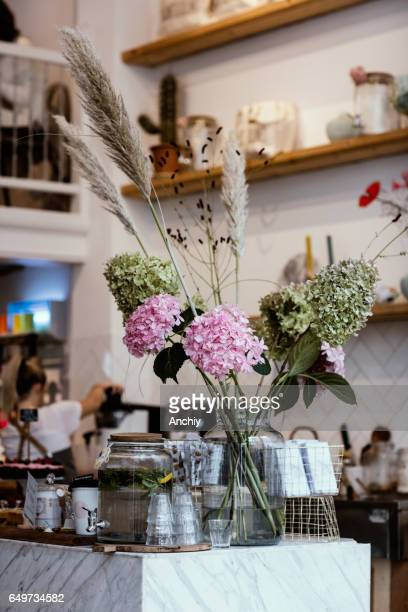 Flowers, cucumber water, coffee shop