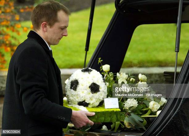 Flowers donated by Newcastle United are placed on the coffin of former Celtic Newcastle United and Scotland player Ronnie Simpson outside St Ninians...