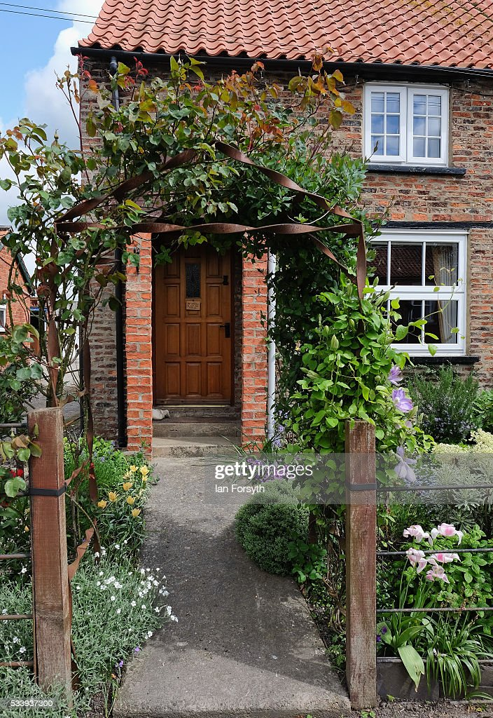 Flowers fill the garden of a home in the village of Kirby Misperton in North Yorkshire near the site of the KM8 fracking site on May 24, 2016 in Malton, England. North Yorkshire's Planning and Regulatory Committee voted seven to four in favour of a planning application submitted by Third Energy to carry out fracking at the KM8 site. Hydraulic fracturing, or fracking, is a technique designed to recover gas and oil from shale rock.