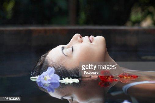 Flowers floating near woman's head