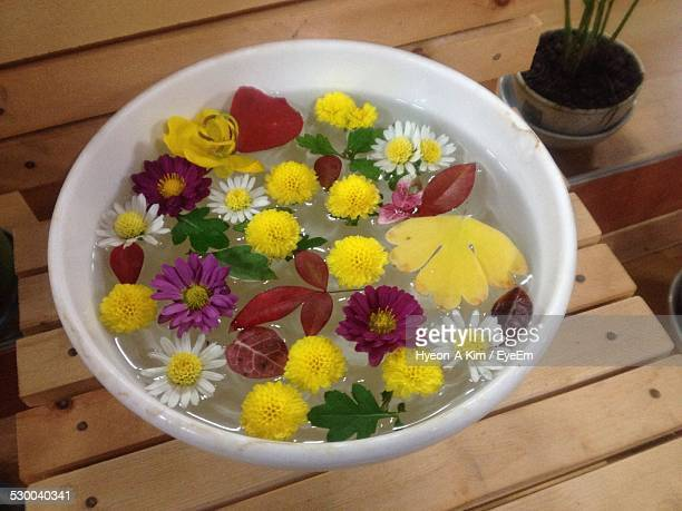 Flowers Floating On Bowl At Home