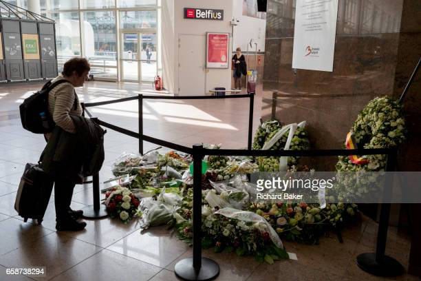 Flowers form the memorial to those passengers and travellers killed in Brussels Zaventem airport a year afterwards on 26th March 2017 at Brussels...