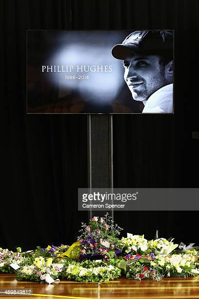 Flowers given to the Hughes family are laid inside the Macksville High School Stadium ahead of the Funeral Service for Phillip Hughes on December 3...