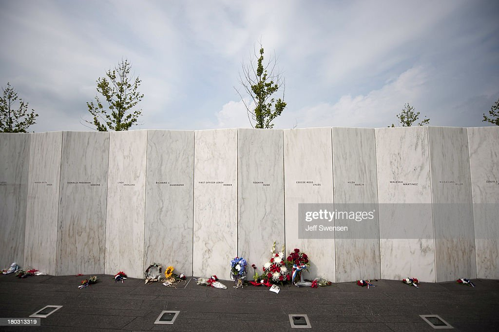 Flowers grace the names wall following a visit by United States Secretary of the Interior Sally Jewell at the Flight 93 National Memorial during ceremonies commemorating the 12th anniversary of the 9/11 attacks on September 11, 2013 in Shanksville, Pennsylvania. The nation is commemorating the anniversary of the 2001 attacks, which resulted in the deaths of nearly 3,000 people after two hijacked planes crashed into the World Trade Center, one into the Pentagon in Arlington, Virginia and one crash landed in Shanksville, Pennsylvania.