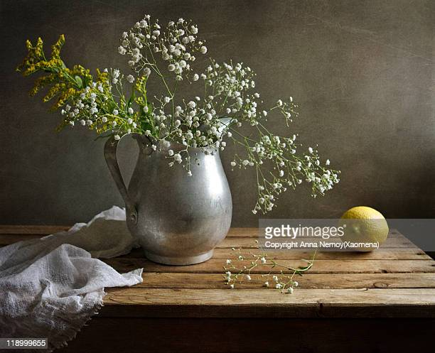 Flowers gypsophila in alluminium pitcher, lemon