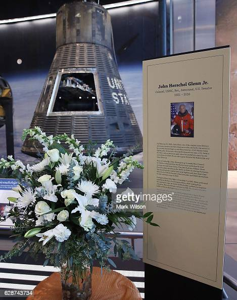 Flowers have been placed at the Frendship 7 Mercury capsule exhibit to honor former Astronaut and US Senator John Glenn at the National Air and Space...