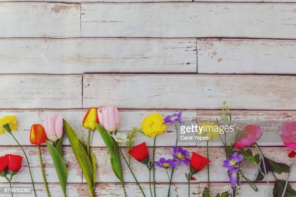 flowers in a wooden table background