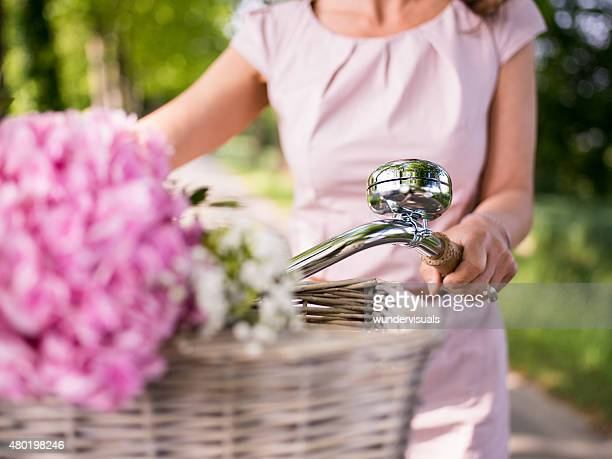Flowers in basket of a classic bicycle in a park