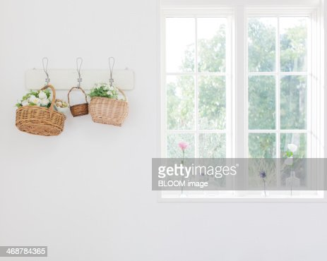 Flowers in baskets on wall
