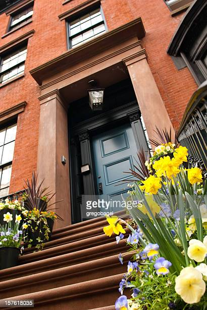 Flowers in front of Manhattan brownstone