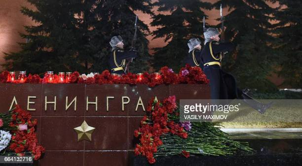 Flowers in memory of victims of the blast in the Saint Petersburg metro are seen at a memorial stone reading Leningrad by the Kremlin wall as honour...