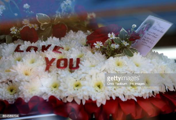 Flowers in tribute of former Tennis player Elena Baltacha arrives at St Johns Church in Ipswich Suffolk for her funeral service