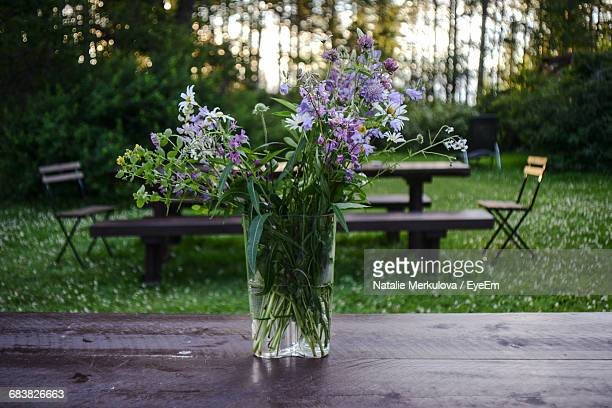 Flowers In Vase On Picnic Table