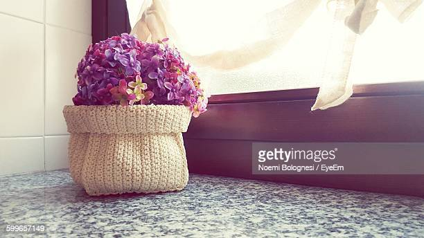Flowers In Whicker Basket At Window Sill