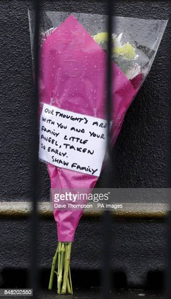 Flowers inside a cordon close to the scene of a suspected gas blast in Buckley Street in the Shaw area of Oldham Greater Manchester in which...