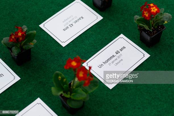 Flowers laid by members of the group 'les Morts de la Rue' and a sign reading 'A man 40yearsold January 21 2017 in Libourne' are on display Place du...