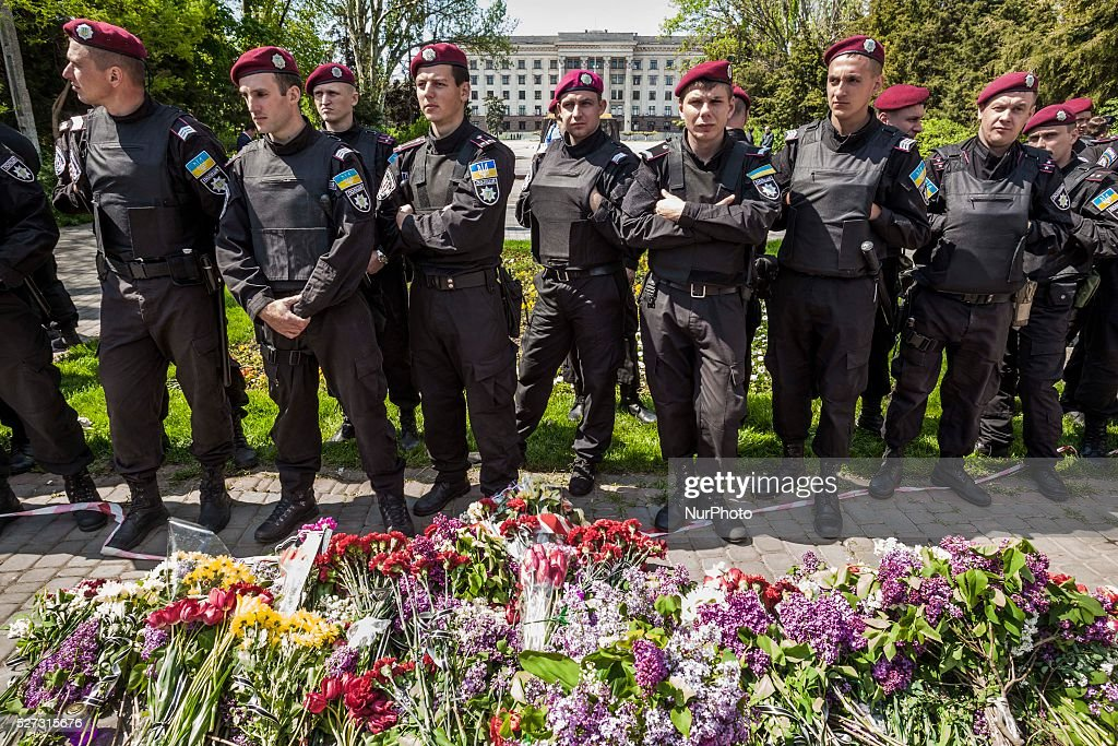 Flowers laid in front of the police riot during the remembrance of the dead people in the 2nd anniversary of May clashes in Odessa, southern Ukraine, on May 2, 2016. The Kulikovo Pole square was closed because a bomb threat.