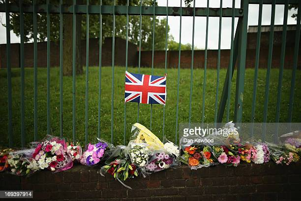Flowers lay close to the scene where Drummer Lee Rigby of the 2nd Battalion the Royal Regiment of Fusiliers was killed on May 24 2013 in London...