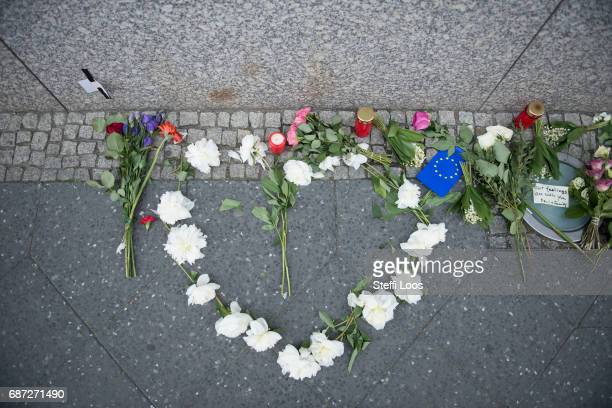 Flowers lay in shape of a heart in front of British Embassy on May 23 2017 in Berlin Germany An explosion occurred at Manchester Arena as concert...