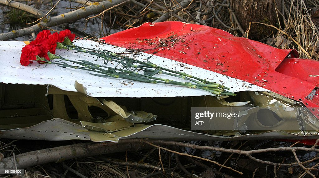 Flowers lay on the wreckage of crashed Polish government Tupolev Tu154 aircraft near Smolensk airport on April 11 2010 The bodies of Polish president...