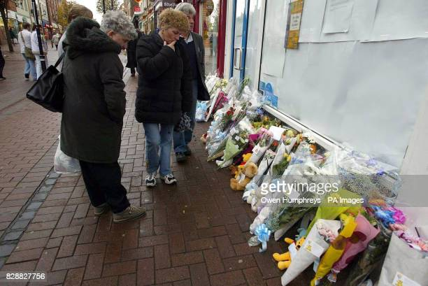 Flowers left at the Greggs Bakery in Carlisle for a 10monthold boy who was in the bakery with his mother Lorna when he was stabbed in the neck...