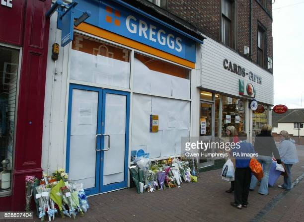 Flowers left at the Greggs Pastry shop in Carlisle after a 10monthold baby died after he was stabbed in the neck in a shop police said A spokesman...
