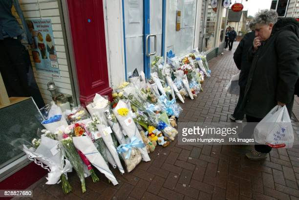 Flowers left at the Greggs Pastry shop in Carlisle for a 10monthold boy who was in the bakery with his mother Lorna when he was stabbed in the neck...