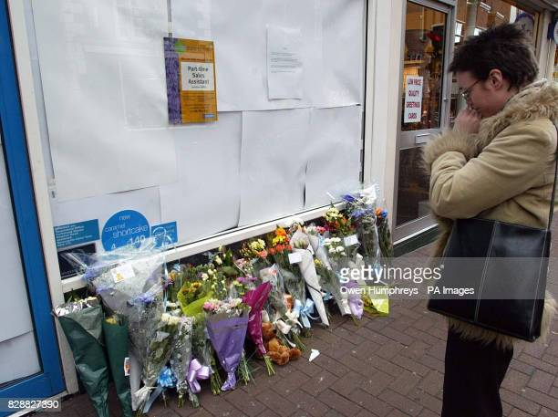 Flowers left at the Greggs Pastry shop in Carlisle Tuesday 21st October 2003 after a 10monthold baby died after he was stabbed in the neck in a shop...