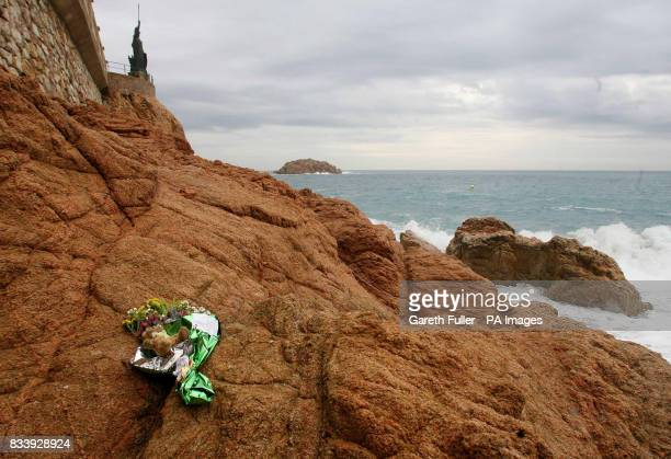 Flowers left by a local English resident on rocks at the beach in Tossa de Mar in Spain where Symon Howlett and his son Jay drowned after being swept...