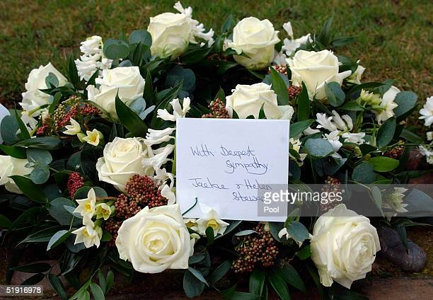 Flowers left by racing car driver Jackie Stewart are seen at the funeral of Sir Angus Ogilvy held in St Georges Chapel of Winmdsor Castle on January...