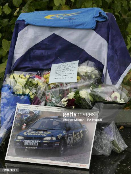Flowers left by the Scottish Subaru Imprezza owners club at the entrance to Colin Mcrae's house after he died in a helicopter crash in the grounds...