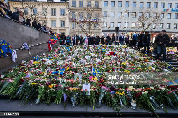 Flowers left on the stairs of Sergelstorg ahead of a 'Love Manifestation' on April 9 2017 in Stockholm Sweden An Uzbek man has been arrested held on...