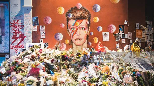 Flowers letters and other tributes left on a mound continue to grow two weeks after the death of Brixton born English singer songwriter David Bowie...